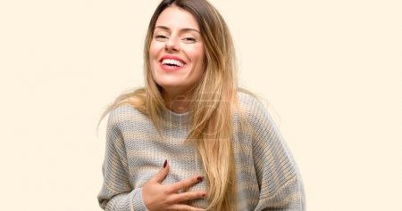 Photo for Young beautiful woman confident and happy with a big natural smile laughing - Royalty Free Image
