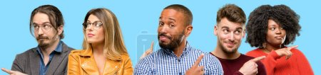 Photo for Group of mixed people, women and men pointing away side with finger - Royalty Free Image
