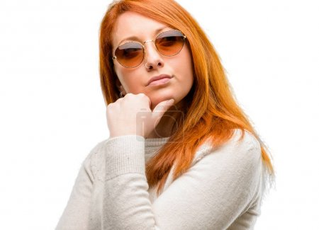 Photo for Beautiful young redhead woman doubt expression, confuse and wonder concept, uncertain future isolated over white background - Royalty Free Image
