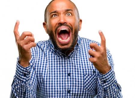 African american man with beard terrified and nervous expressing anxiety and panic gesture, overwhelmed isolated over white background