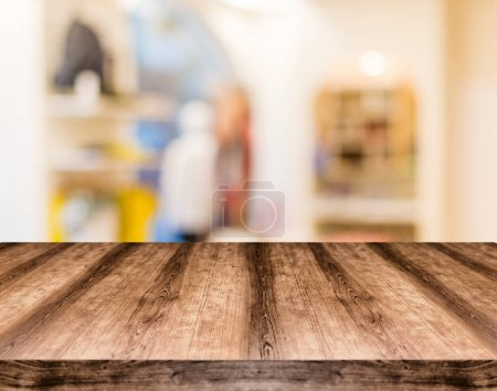 Photo for Wooden empty table board in front of blurred background. Can be used for display or montage any product. Mock up for display your product. - Royalty Free Image