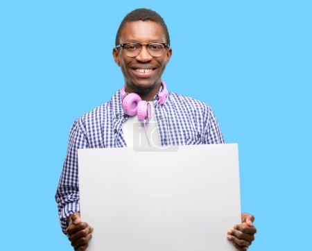 African black man student with smartphone holding blank advertising banner, good poster for ad, offer or announcement, big paper billboard