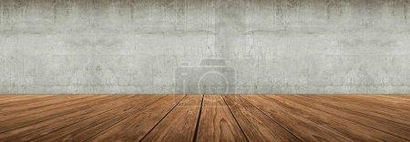 Photo pour Grand plancher en bois contre mur en béton - image libre de droit