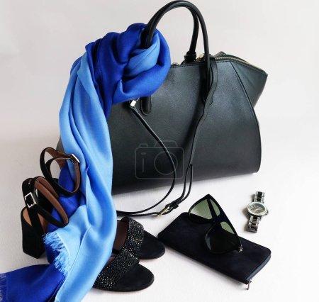 Photo for Fashion woman accessories set. Trendy fashion black shoes heels, stylish handbag , sunglasses, watches and blue silk skarf. Elegant, luxury. Top view - Royalty Free Image