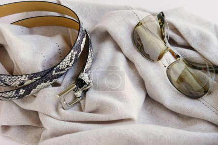 Luxurious cashmere beige sweater, sunglasses and belt