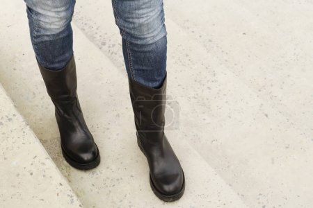 women's legs in jeans and boots