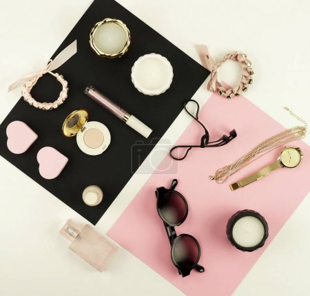 woman trendy fashion accessories and cosmetics arrangement