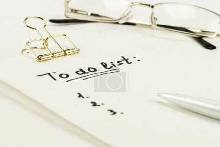 """""""to do list"""" is written on notepad with pen"""