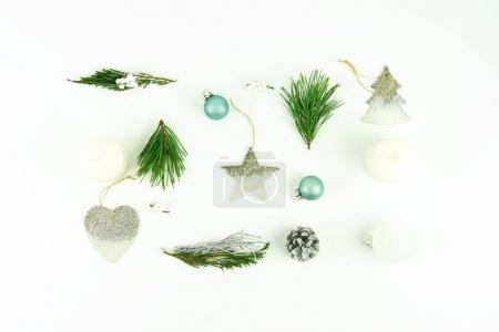 christmas background. creative abstract composition of xmas decorations, branches of Christmas tree, gifts, balls on white background.Flat lay. Top view. Copy space