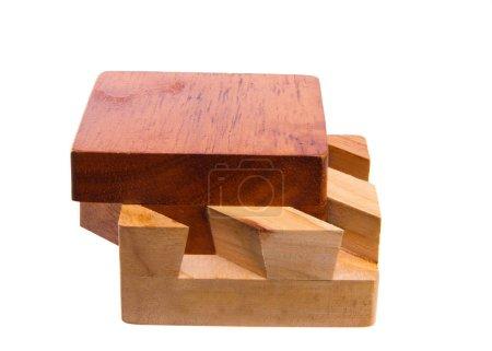 Photo pour Puzzle cube en bois sur fond blanc, isolé, gros plan - image libre de droit