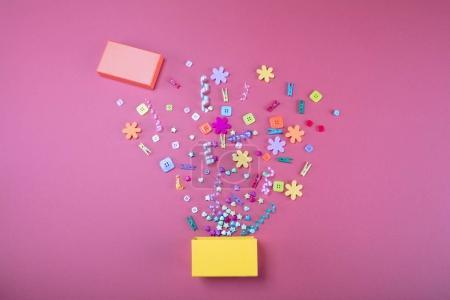 Exploding celebration yelow gift box. Holidays concept.