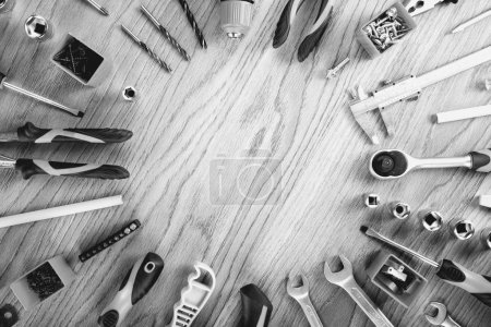 Photo for Construction tools on a wooden desk, top view, flat lay. Tools sailing and workers concept. - Royalty Free Image