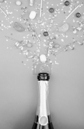 Champagne splashes of black & white confetti on a gray background. Winer of championship concept.