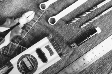 Uniform and construction tools, top view, flat lay. Tools sailing and workers concept.