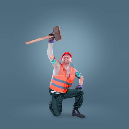 Construction worker with helmet and hammer. Taking hammer over his had. Builder or buiding concept.