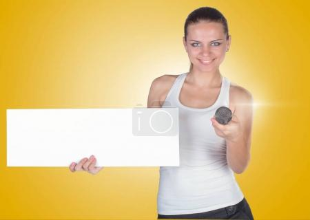 Beautiful young woman with a white empty blank pose in the studi