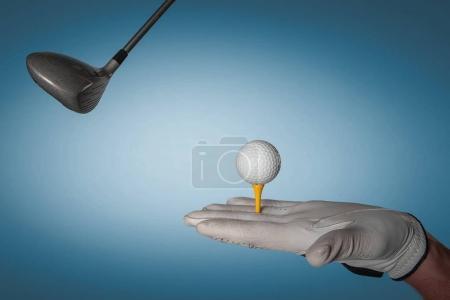 Man hand in professional golf glove holding golf equipment