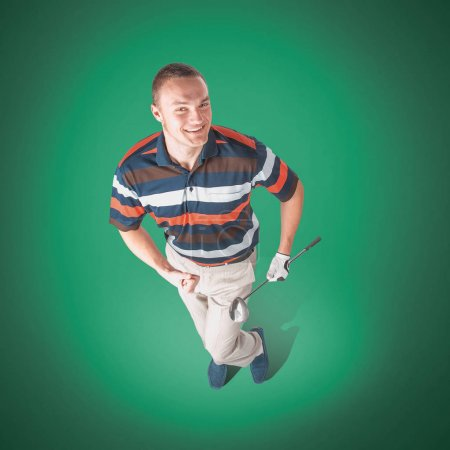 Emotional handsome golfer player pose in studio on blue and gree