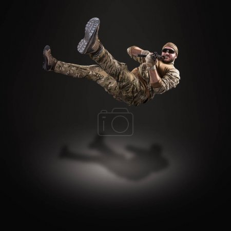 USA Army soldier with  gun (motion effect).  Shot in studio on b