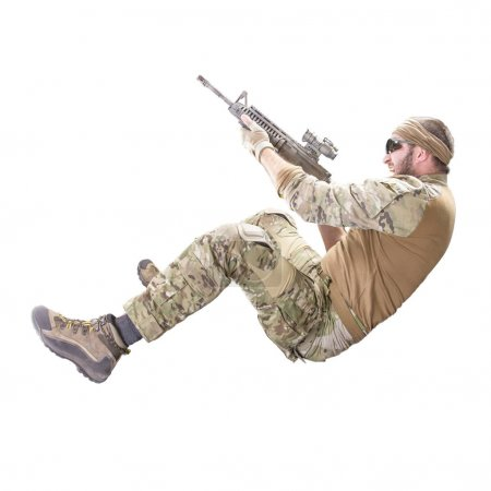 USA Army soldier with rifle (motion effect).  Shot in studio on