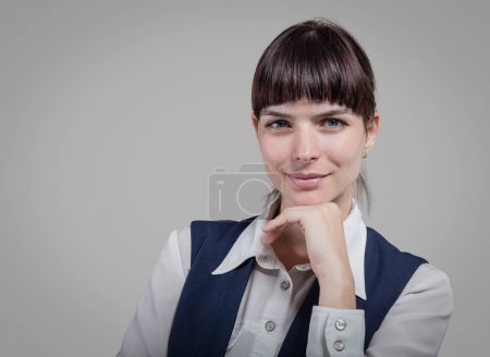 business woman holding tablet on gray background. Studio shoot