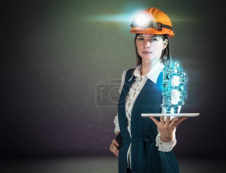 Business woman in helmet mine with a bitcoin sign. Studio shoot.