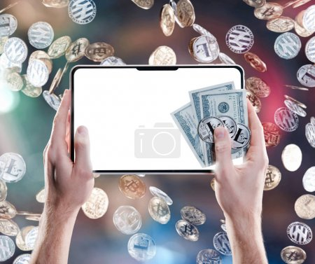 Hands holding mobile tablet with empty screen and bitcoin coins, dollar bills against the backdrop of flying coins. Digital monitoring, checking and money exchange cryptocurrency concept