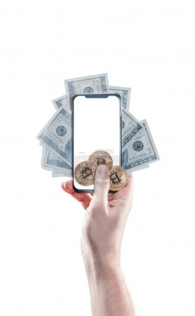Hand holding mobile phone with empty screen and bitcoin coins, dollar bills against the the white background. Digital monitoring, checking and money exchange cryptocurrency concept