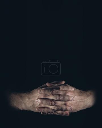 man hands on black background