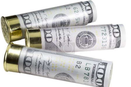 Three 12 gauge shotgun shells loaded with hundred us dollar bills. Isolated on white background.
