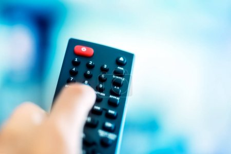 TV remote over blue screen background