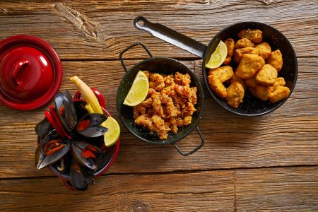 Photo for Fish seafood tapas adobo squid and steamed mussels of spain - Royalty Free Image