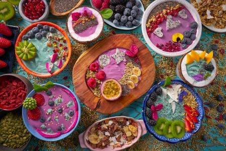 Photo for Acai bowl smoothie and Spirulina algae with chia berries and fruits healthy food - Royalty Free Image