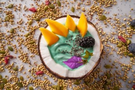 Spirulina bowl smoothie in coconut blackberry mango