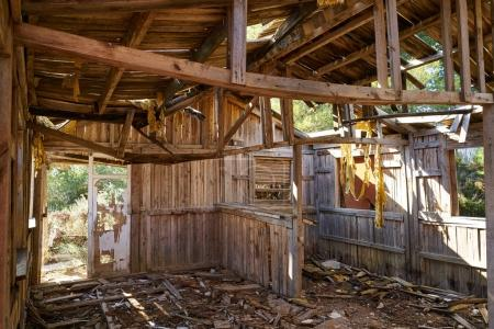 Old wooden cabin house destroyed by hurricane