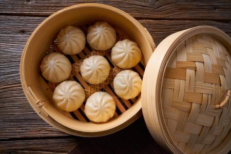 steamed pork buns in bamboo steamer
