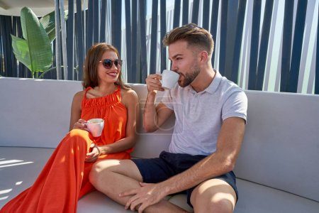 Photo for Young copule having coffee in lounge bar outdoor - Royalty Free Image