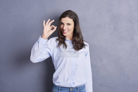 young woman showing the ok sign