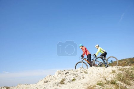 Mountain bikers training at the hillside