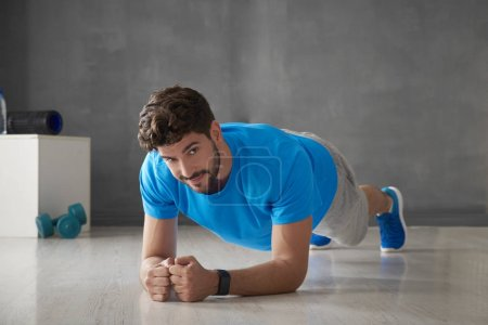 young man doing plank