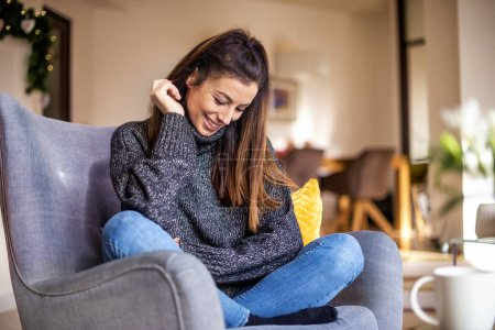 Shot of an attractie smiling woman wearing turtlen...