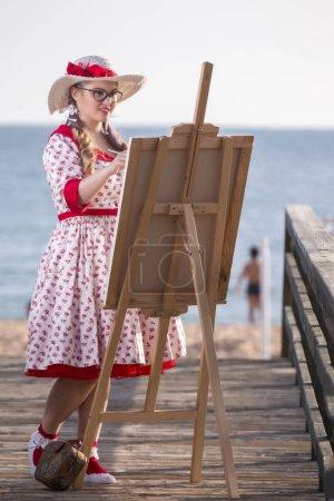 Cute pinup girl in the beach