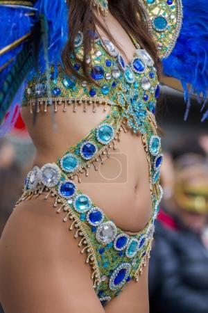 Colorful Carnival (Carnaval) Parade festival famel participant dancing.