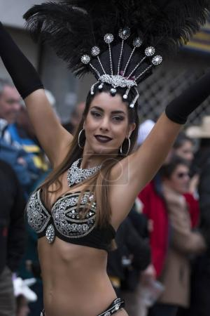 LOULE, PORTUGAL - FEBRUARY  2018: Colorful Carnival festival participants on Loule city, Portugal.