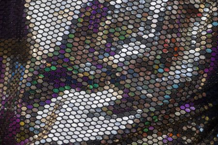 Close up view of a highly reflective texture of Carnival suit.