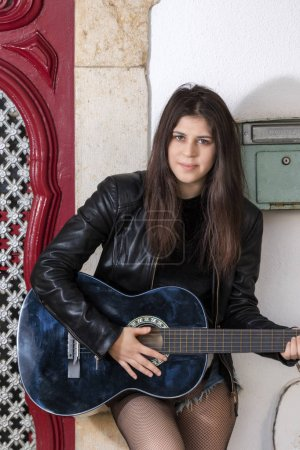 Young woman with classic guitar