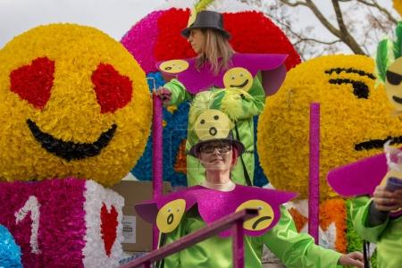 LOULE, PORTUGAL - FEB 2018: Colorful Carnival festival participants on Loule city, Portugal.