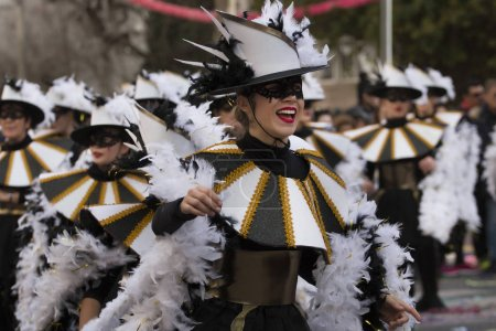 LOULE, PORTUGAL - FEB 2018: Colorful Carnival Parade festival participants on Loule city, Portugal.
