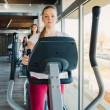 Young beautiful girls exercising in the gym with s...