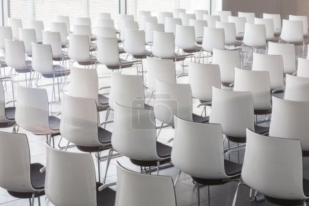 Photo for Interior of empty contemporary conference hall with white chairs. - Royalty Free Image